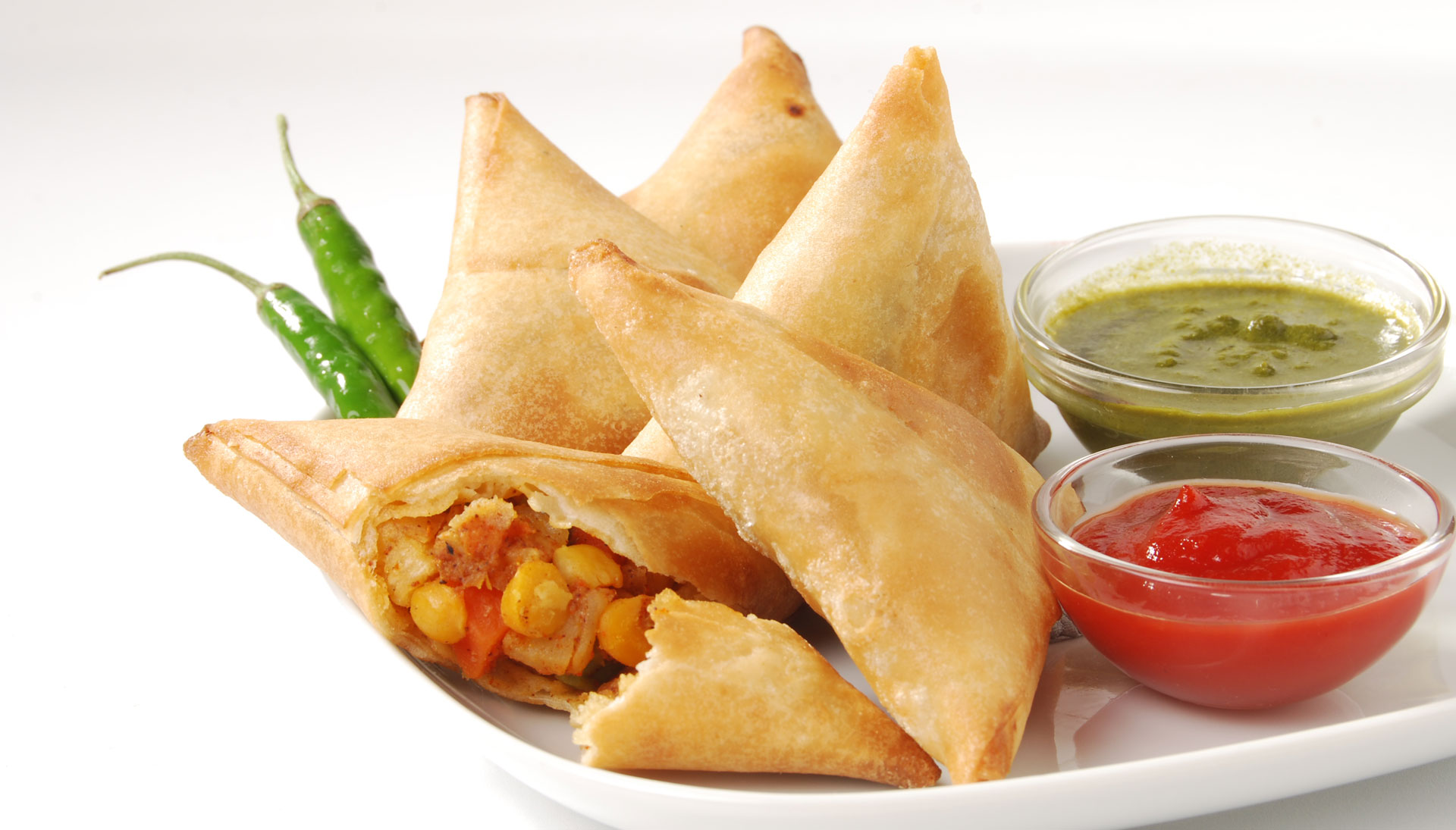 Hand made, exotically spiced, savory Samosas, all folded in a light ...